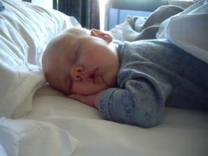 Melissa newborn asleep in our bed
