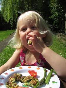 Melissa eating Spring Greens gluten free fritter